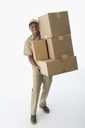 power delivery: African American delivery man carrying boxes