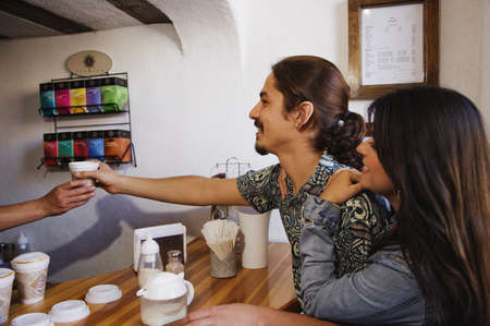 Hispanic couple at coffee shop Stock Photo - 16095318