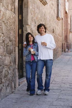 Hispanic couple with coffee on sidewalk Stock Photo - 16095319