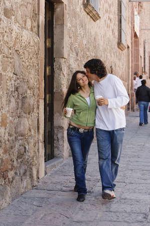 Hispanic couple with coffee on sidewalk Stock Photo - 16095320