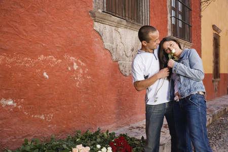 Hispanic couple holding rose Stock Photo - 16095323
