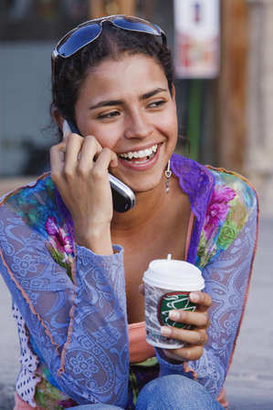 Hispanic woman talking on cell phone Stock Photo - 16095343