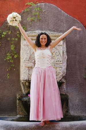 Hispanic girl wearing Quinceanera dress Stock Photo - 16095354
