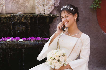 acknowledging: Hispanic girl on cell phone in Quinceanera dress