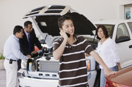 Hispanic family at car dealership Stock Photo - 16095373