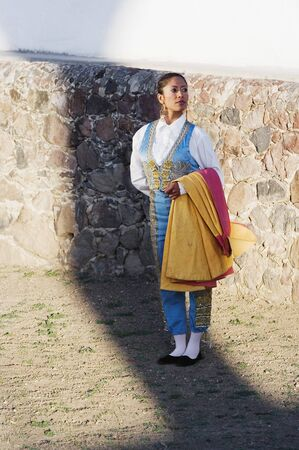 attired: Hispanic woman wearing toreador outfit