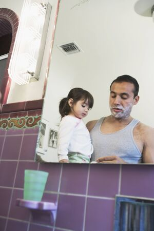 Father shaving with curious toddler girl  Stock Photo - 16095394
