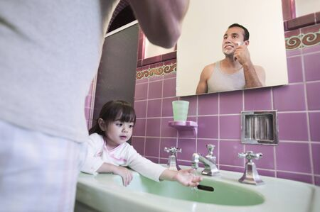 Father shaving with daughter at sink Stock Photo - 16095395
