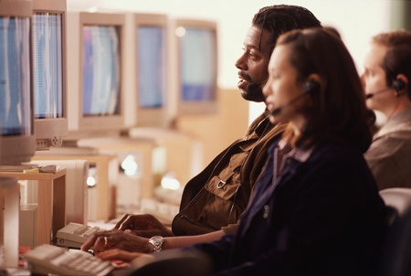 Multi-ethnic businesspeople working in call center Stock Photo - 16095401