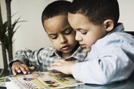 kinfolk: African brothers doing homework LANG_EVOIMAGES