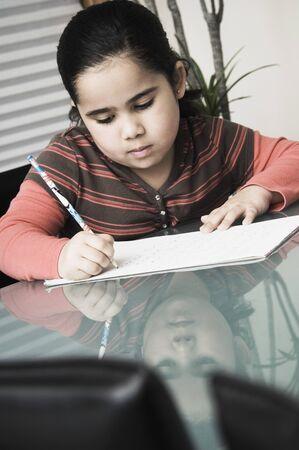 African girl doing homework