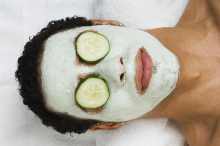 facial: Mixed Race man receiving spa facial treatment