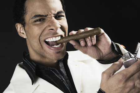 Mixed Race man lighting cigar Stock Photo - 16095426