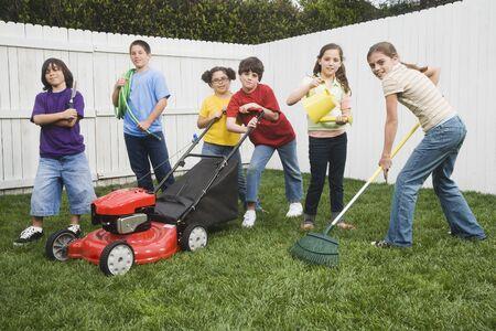 Multi-ethnic children doing yard work Stock Photo - 16095478