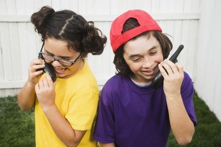Mixed Race children talking on walkie talkies Stock Photo - 16095491