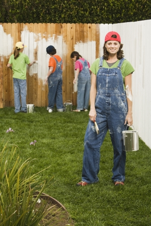 Mixed Race family painting fence Stock Photo - 16095504