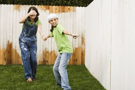 Mother and daughter painting fence Stock Photo - 16095505