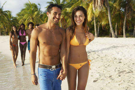 bathing   suit: South American couple walking on beach