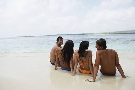 bare chest: South American couples sitting on beach