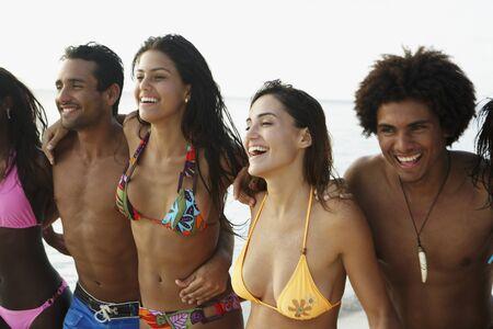 bathing   suit: South American friends walking on beach