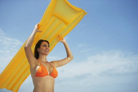 South American woman holding raft 版權商用圖片