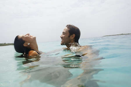 submerge: South American couple in water