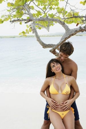 South American couple hugging at beach Stock Photo - 16095672