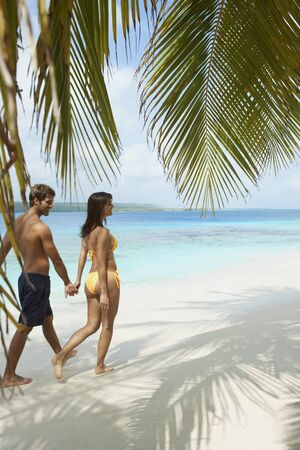 South American couple walking on beach Stock Photo - 16095678