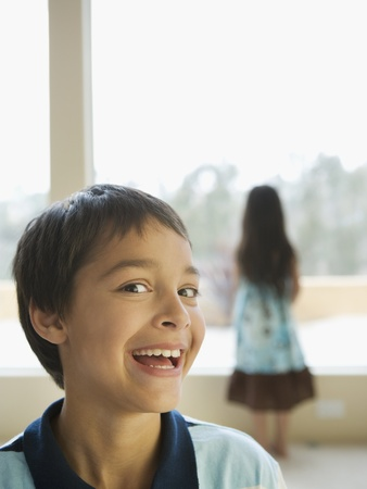 elementary age girl: Hispanic boy laughing