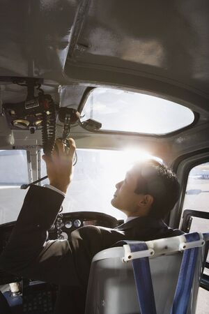 Asian businessman in helicopter Stock Photo - 16095744