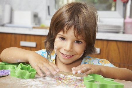 Hispanic girl making cookies Stock Photo