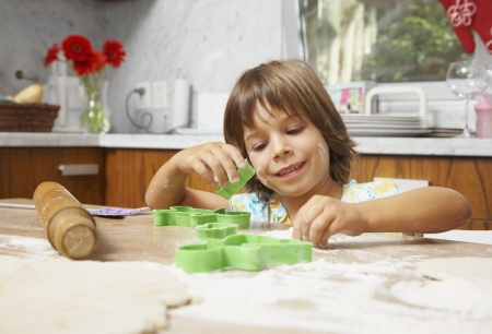 Hispanic girl making cookies Stock Photo - 16095757