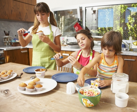 Hispanic sisters making cookies Stock Photo - 16095758