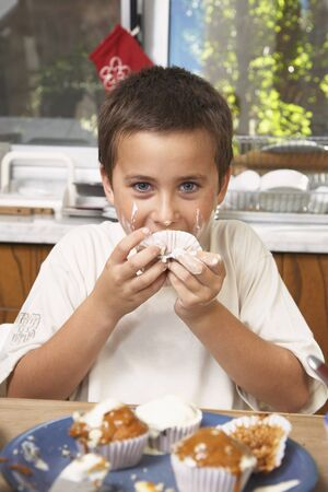 Hispanic boy eating homemade cupcake Stock Photo - 16095760