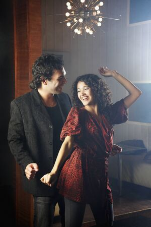 dancing club: Hispanic couple dancing at nightclub