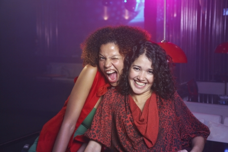 Hispanic women laughing at nightclub Stock Photo - 16095766