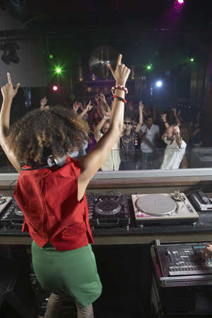 dancing club: Hispanic woman djing at nightclub