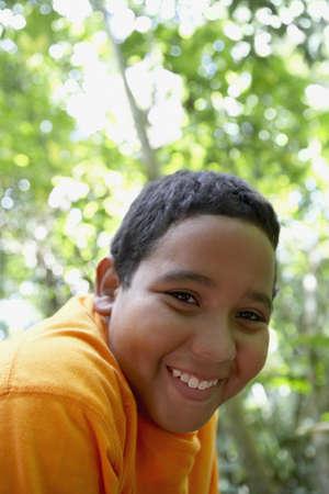 only boys: Close up of Hispanic boy smiling
