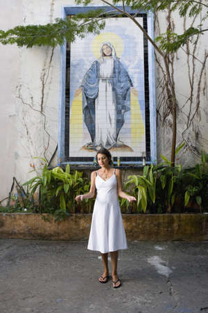 Hispanic woman in front of Virgin Mary mosaic Stock Photo - 16095794
