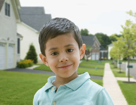 Hispanic boy in residential area Stock Photo - 16095796