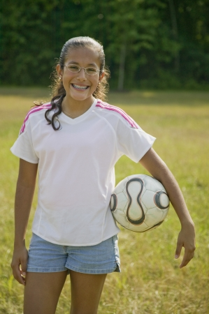 Hispanic girl holding soccer ball