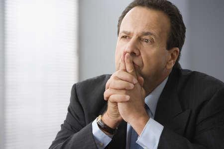 Hispanic businessman thinking Stock Photo - 16095817