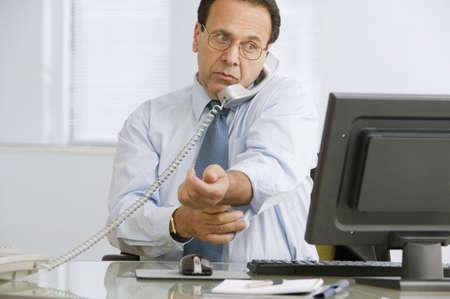Hispanic businessman talking on telephone Stock Photo - 16095818