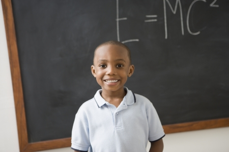 african ethnicity: African American boy in front of black board LANG_EVOIMAGES