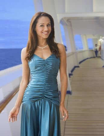evening gown: Hispanic woman in evening gown on ship