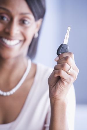 African American woman holding car key Stock Photo - 16095843