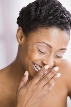 one mid adult woman only: African American woman laughing