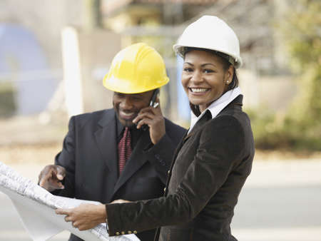 expertise: African American businesspeople with blueprints