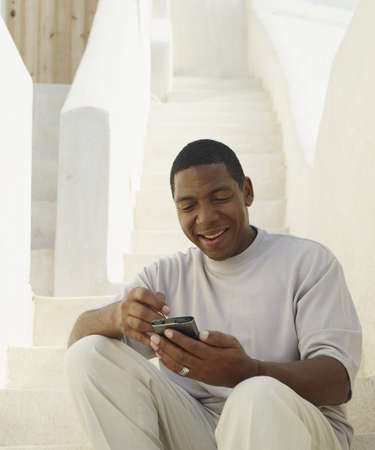 electronic organizer: African American man looking at electronic organizer LANG_EVOIMAGES