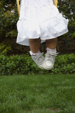 Hispanic girl jumping on grass Stock Photo - 16095969